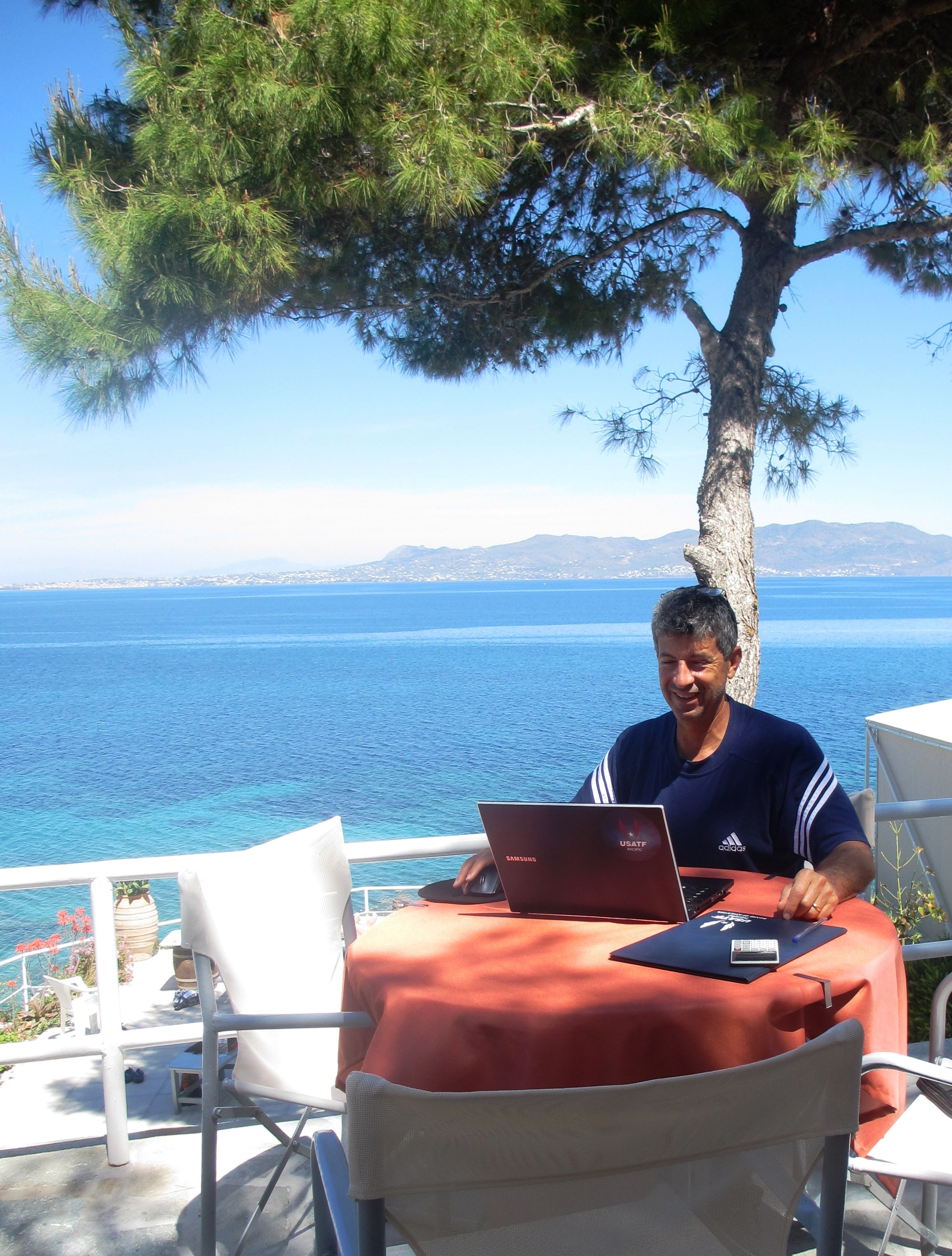 Dr. Shrock grading on-line finals on Agistri, Greece